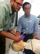 "Rich Smith '16 and Mike Sun '16 monitor their ""patient."""