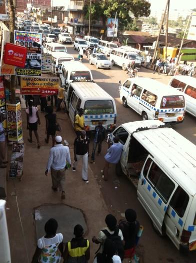 Wandageya, Kampala. A typical street scene of Matatus, Boda-Bodas and pedestrians.
