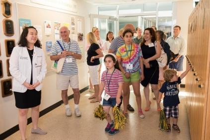 Elaine Wang '18 leads a tour of campus during UVM College of Medicine Reunion 2015.