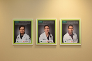 Patients get to know Larner College of Medicine students courtesy of portraits at all three primary care health centers where they are based.