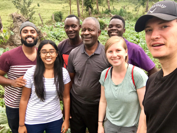 Katie Grenoble (second from right) with fellow global health participants, Dr. Samuel Luboga, and his sons Sam and David